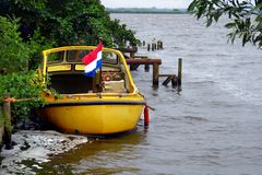 Yellow boat with a flag of the Netherlands