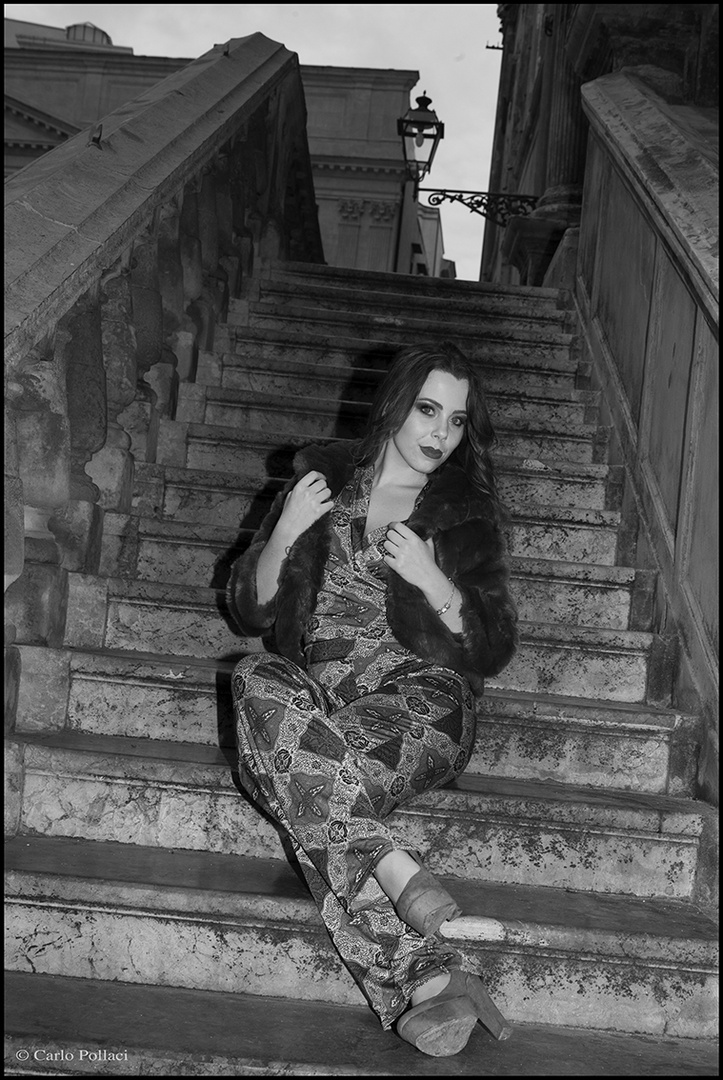 Young lady on the baroque staircase.