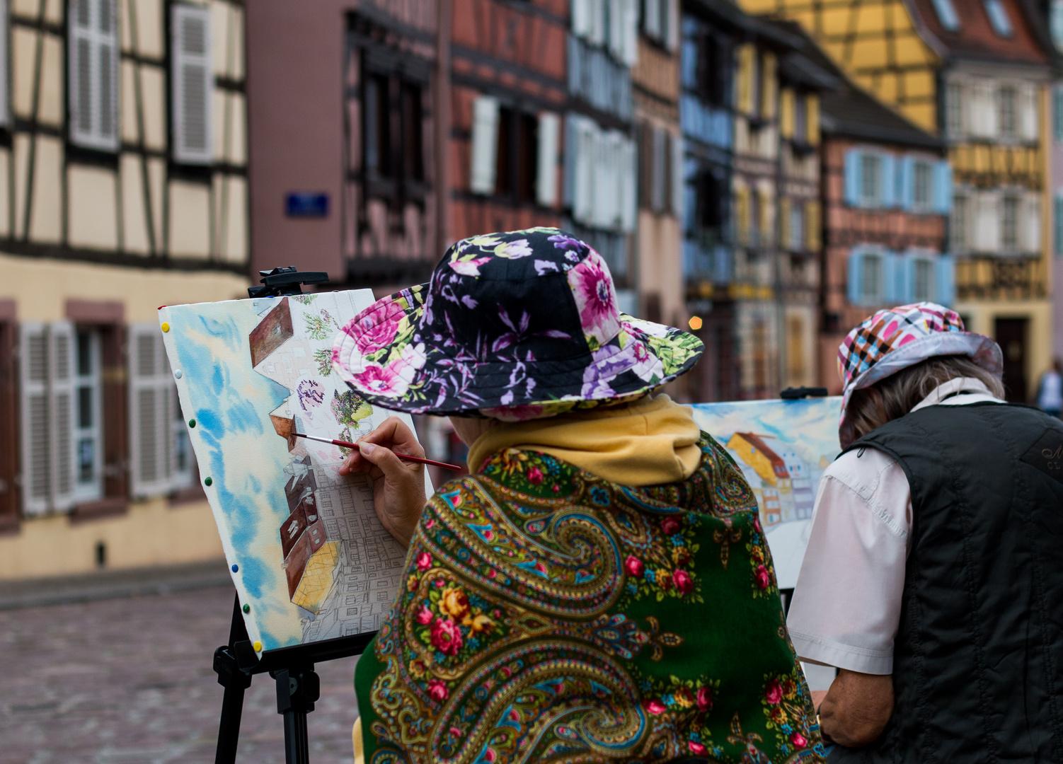 Zeichnerin in Colmar (Frankreich, Elsass)
