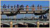 runners on the millennium bridge London by markkeville
