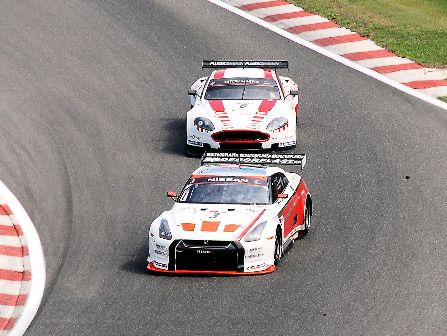#3 Nissan GT-R #8 Aston Martin