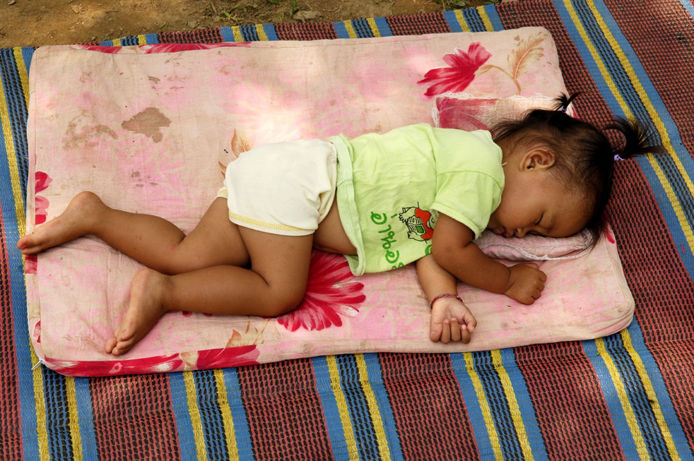 3) Siesta on the sidewalk in Luang Prabang Laos, Bless her soul. Story within!!!