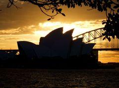 A burning sun sets over Sydney Opera House