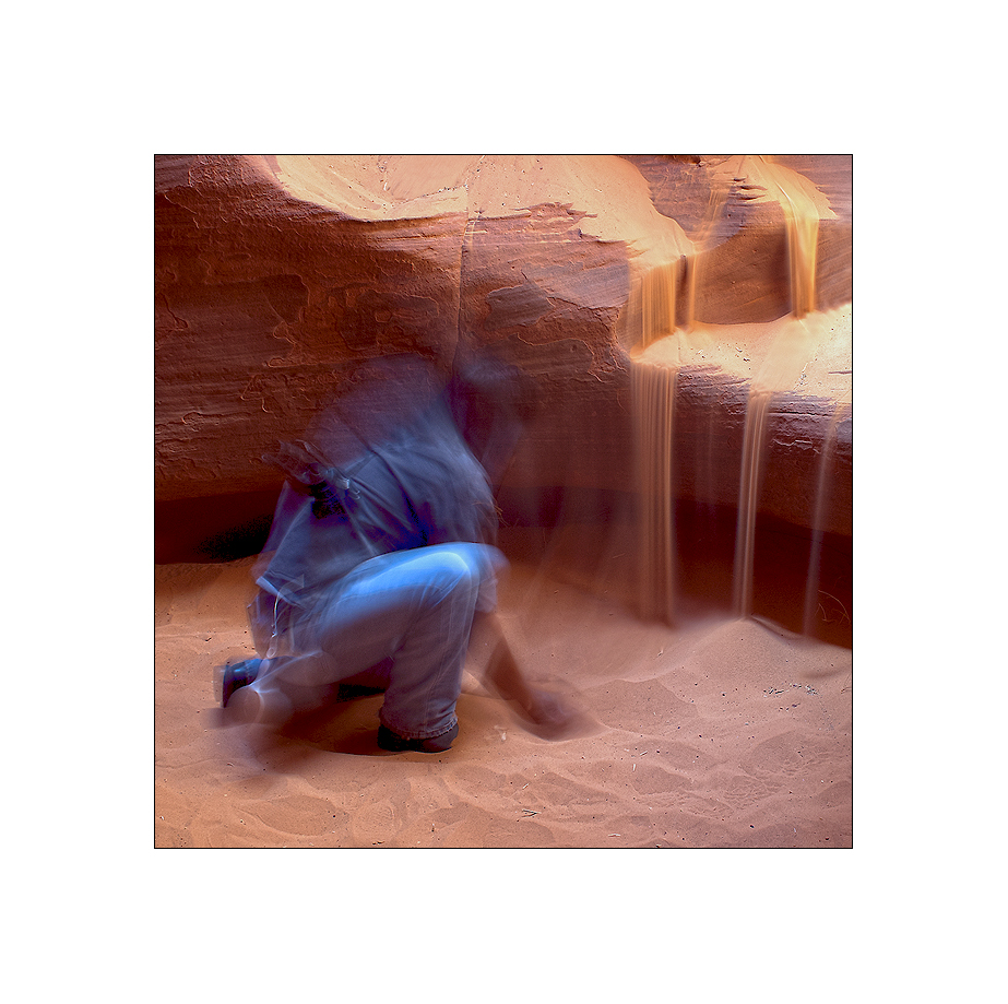 a navajo lets the sand run.
