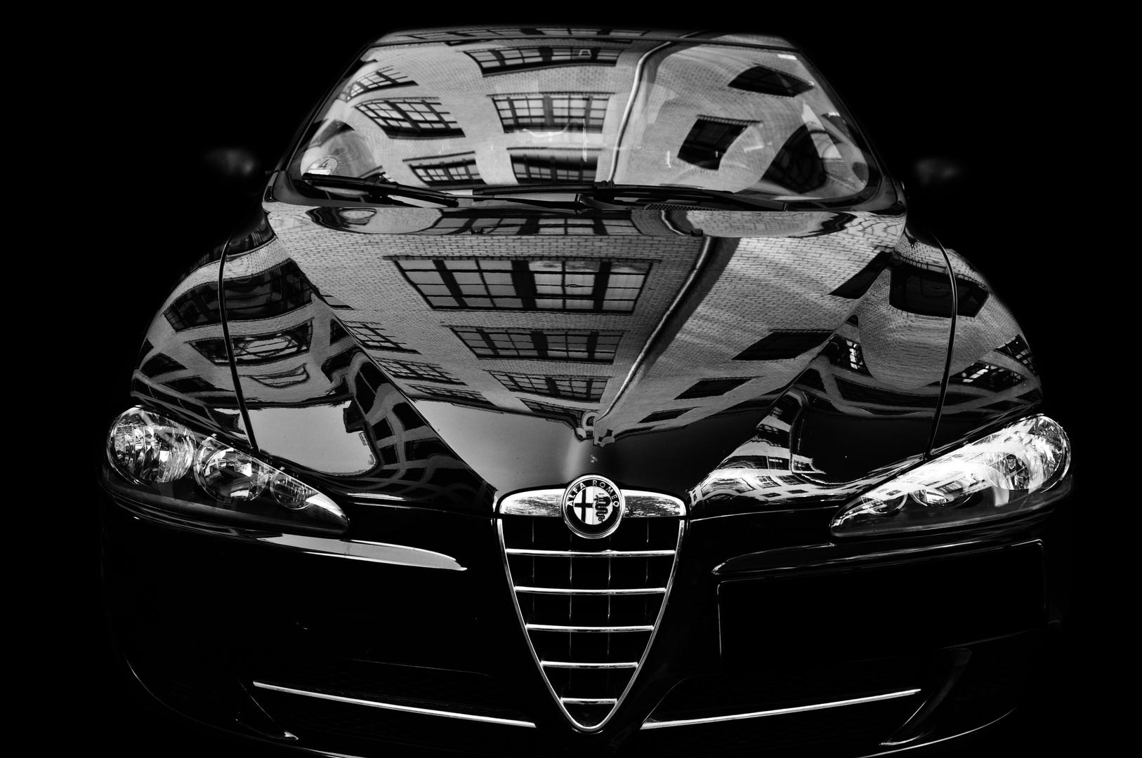 Alfa vor Haus