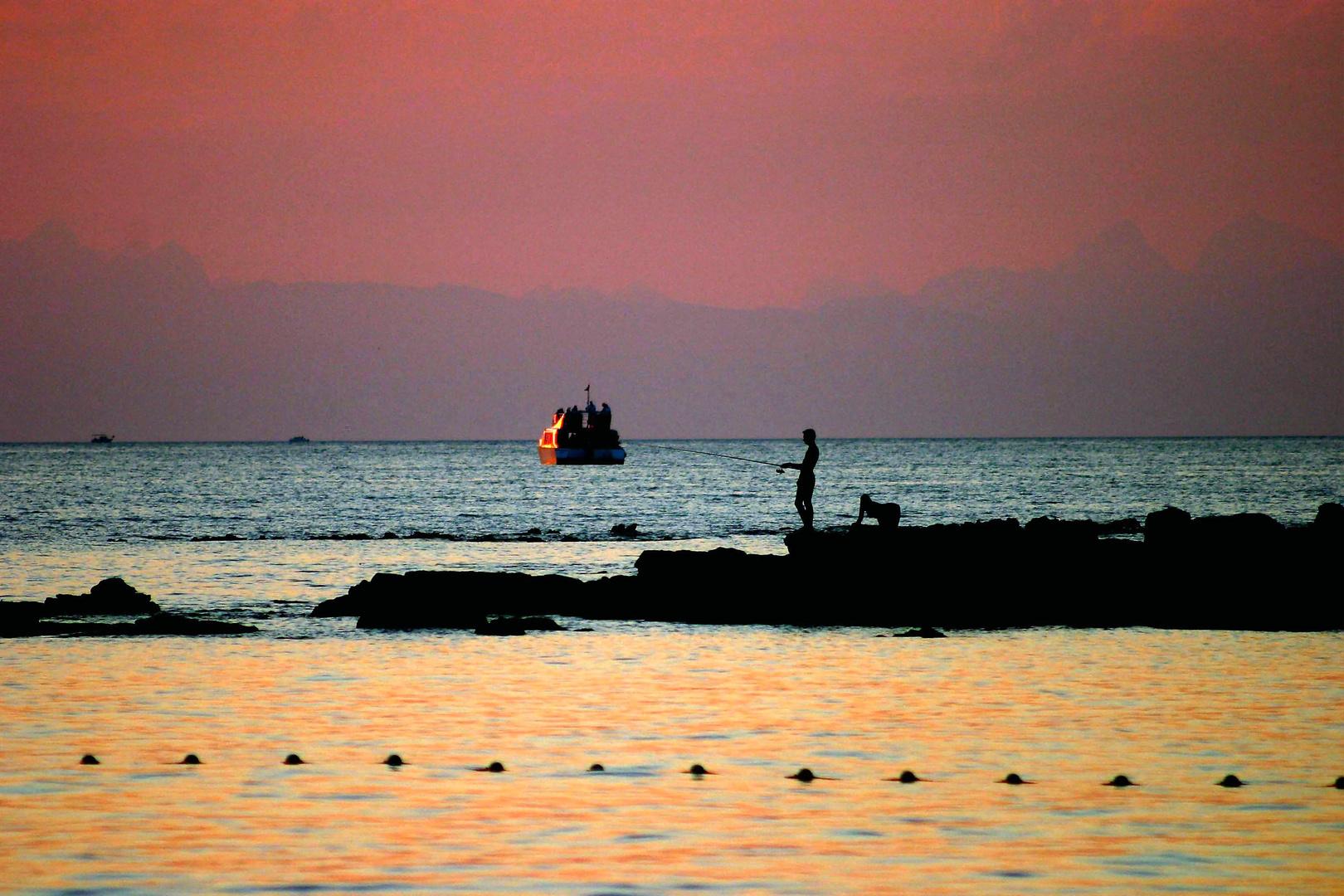 Angler am Abend