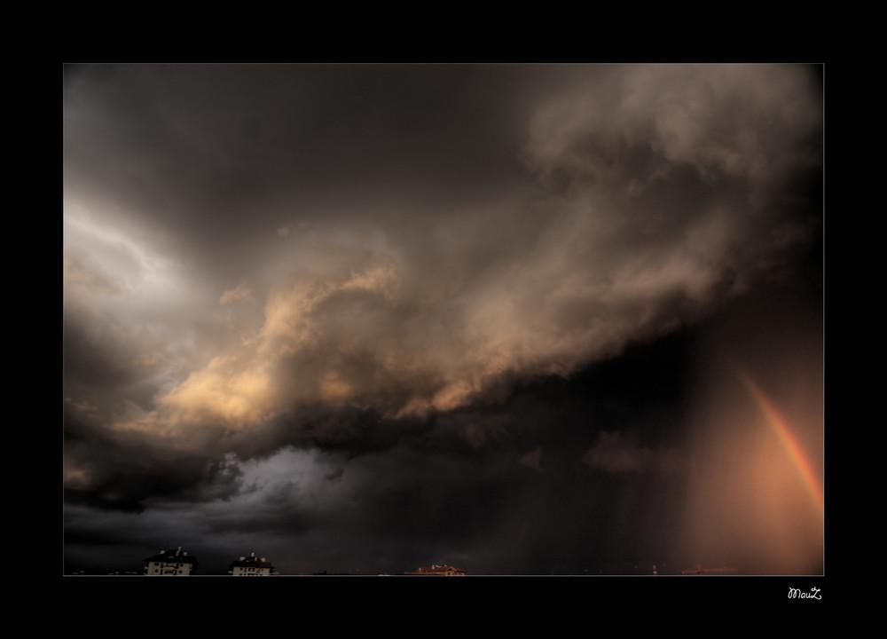 Arcobaleno e tempesta
