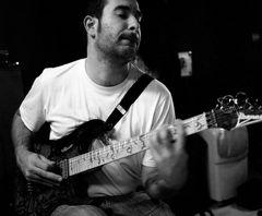 at the guitar....