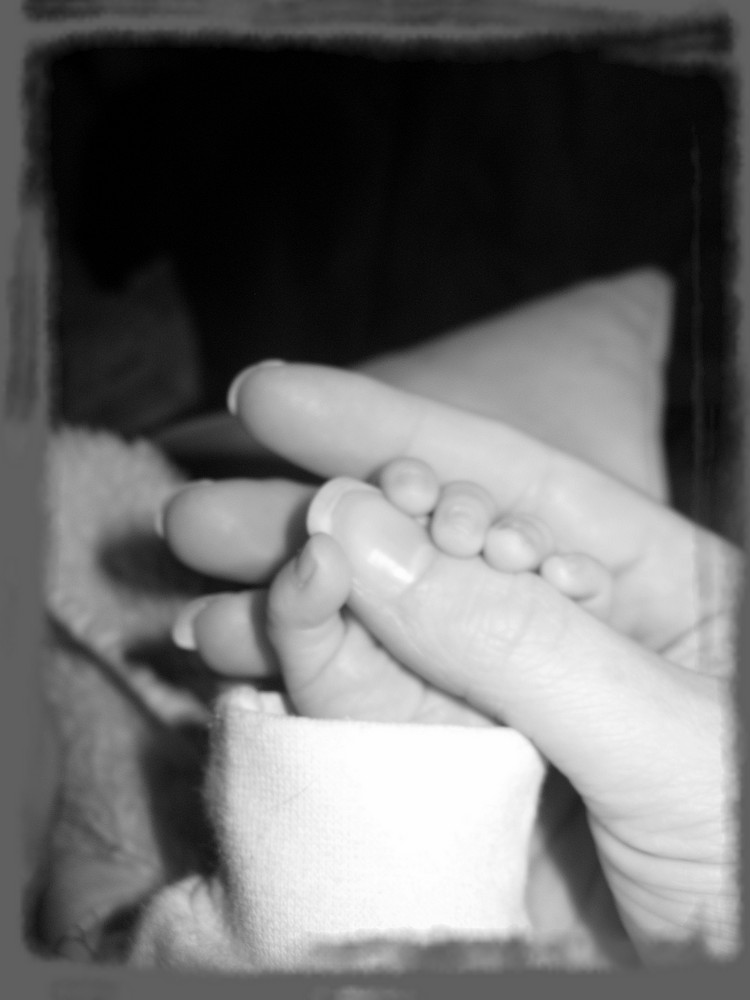 Babys Fingers on Mamis Hand