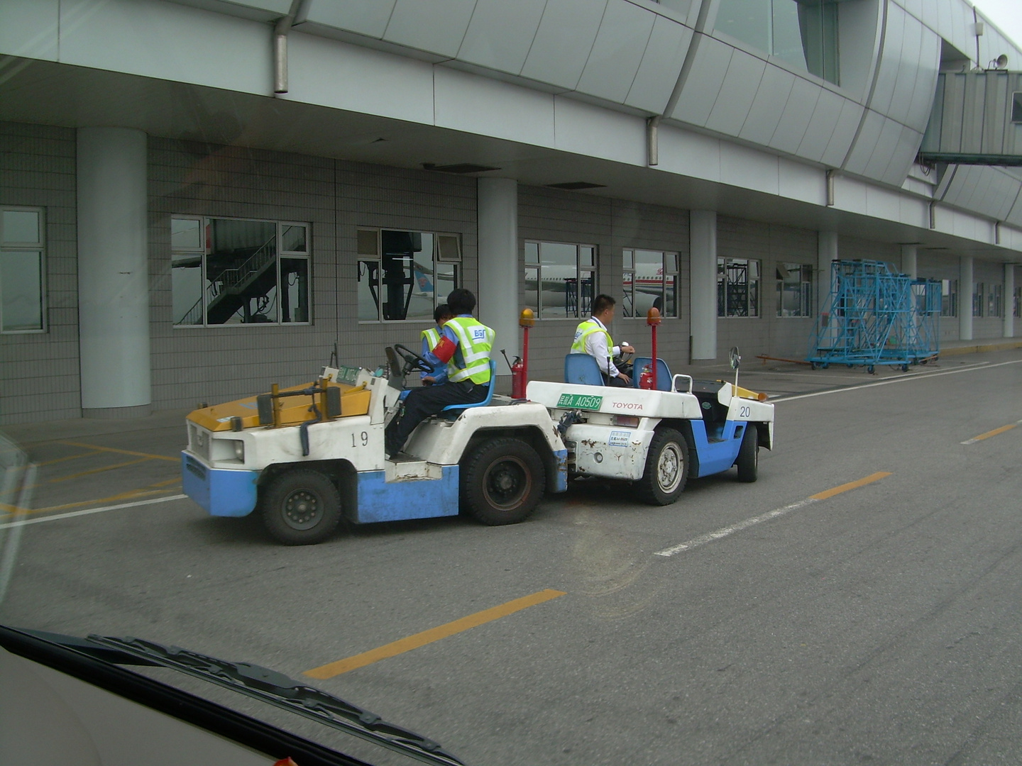baggage tow tractor towing in Beijing Airport summer 2008