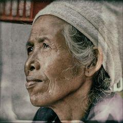 * Balinese market woman.