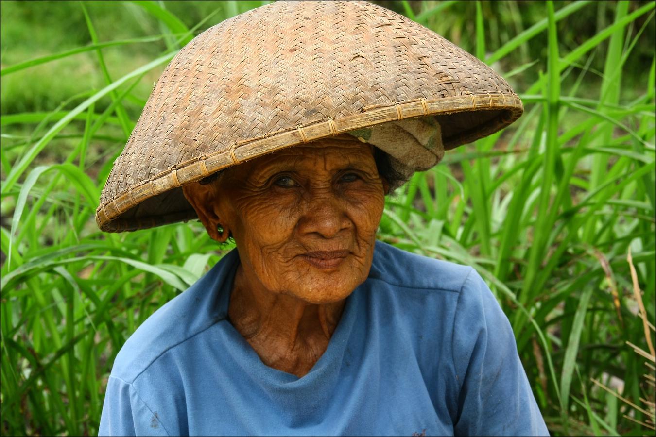 * Balinesische Reisbäuerin *