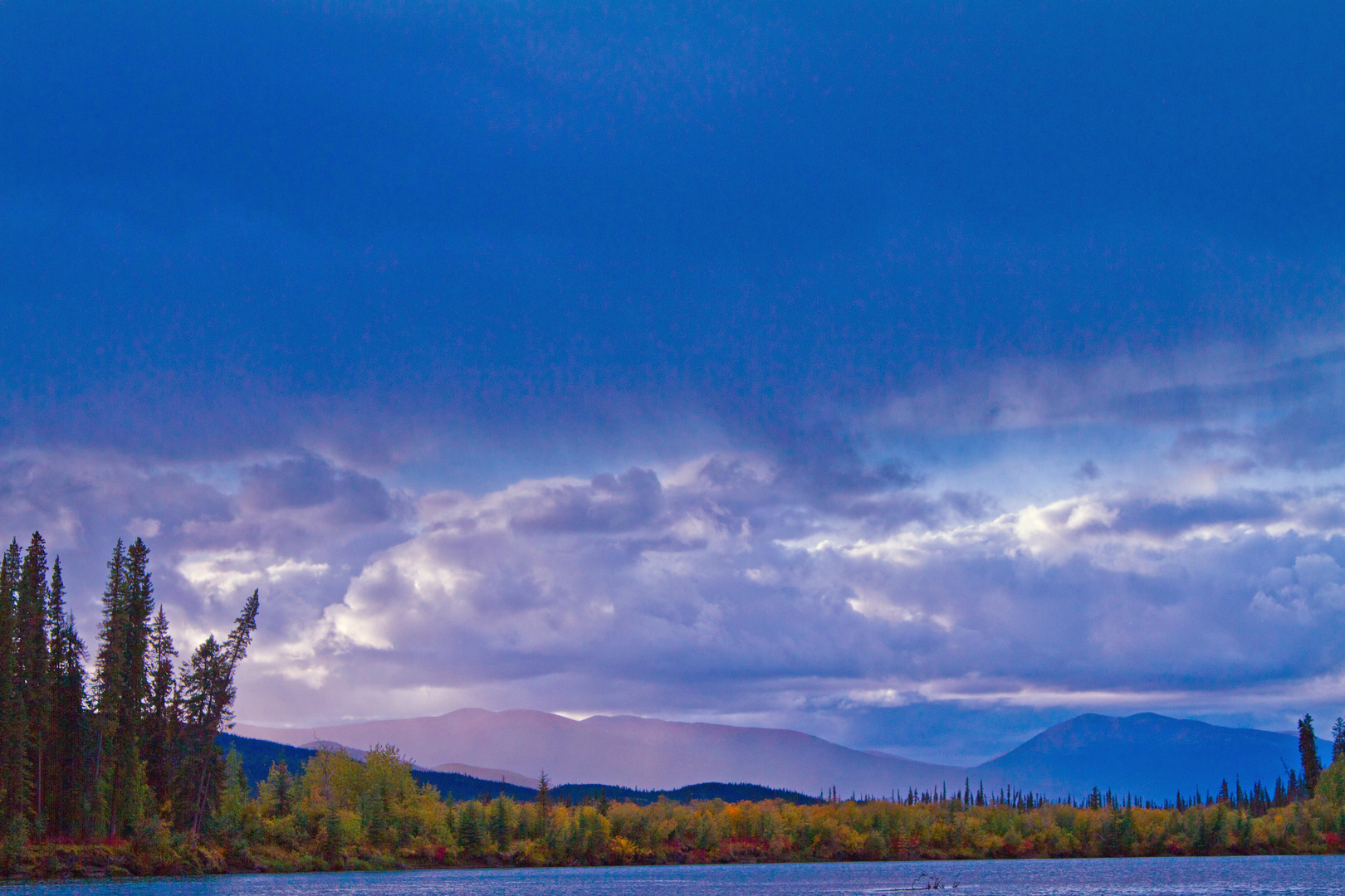 before the rains on the banks of the Nisutlin River, Yukon Territory, Canada