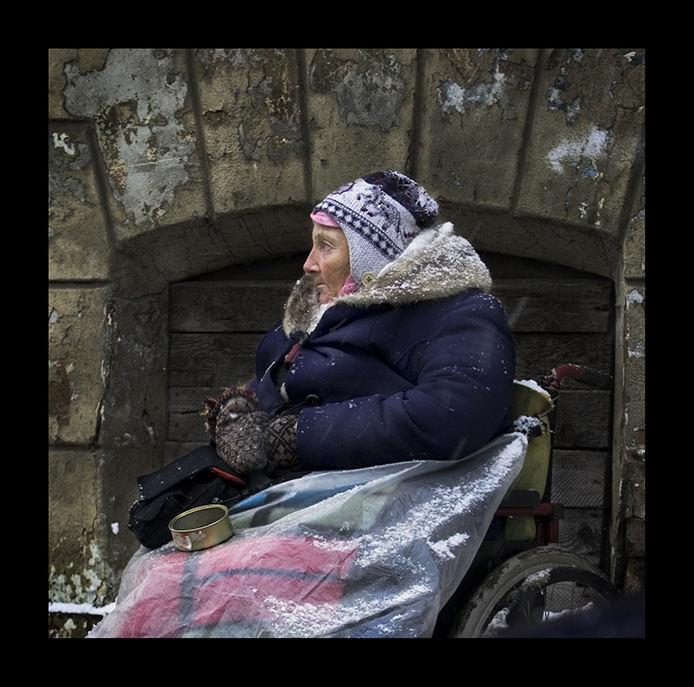 beggar in cold