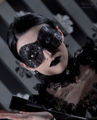 ...behind the black mask