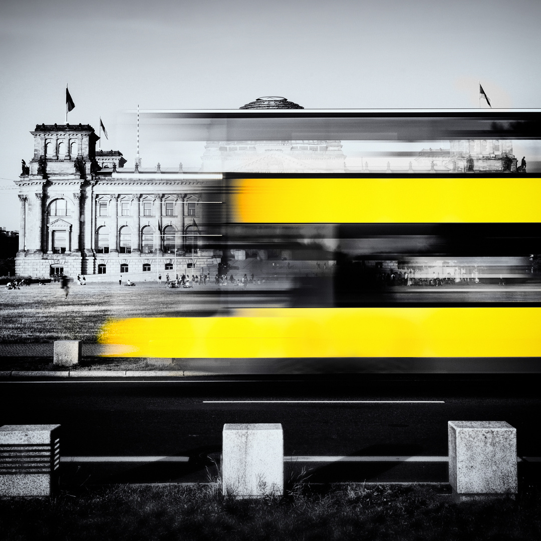 Berlin Reichstag buildung with yellow double-decker bus