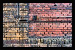 Besen an der Wand