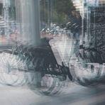 Bicyles mirrored in a Bakery's Door