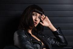 ...black leather jacket...