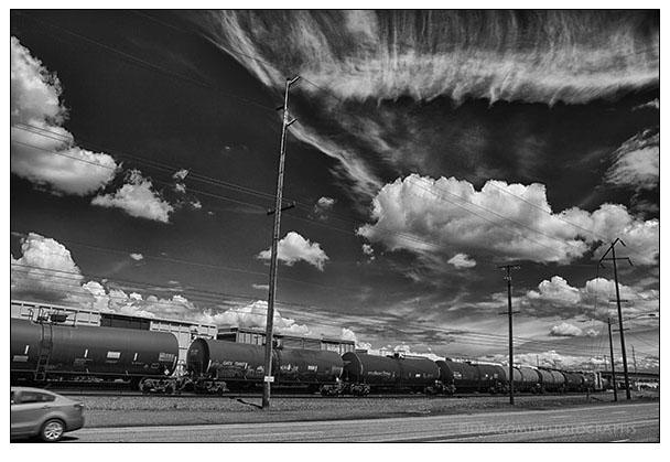 Black Train In Clouds & Car