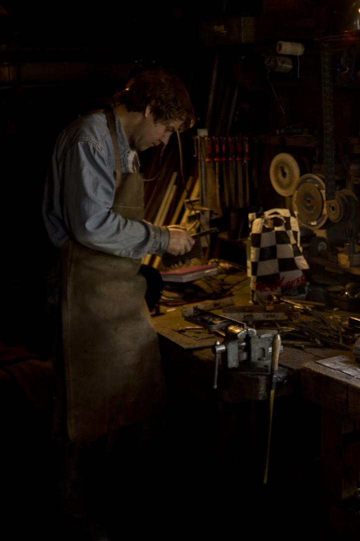 Blacksmith working on lock