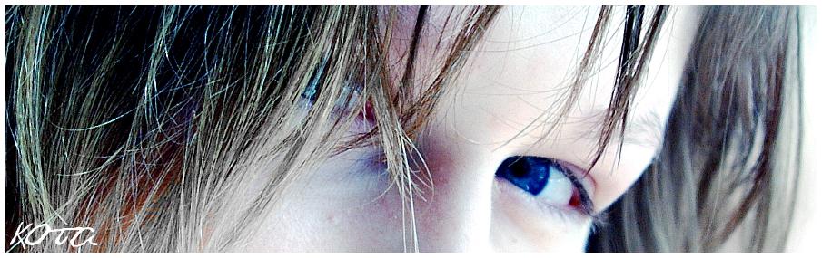blue eyes behind hairs