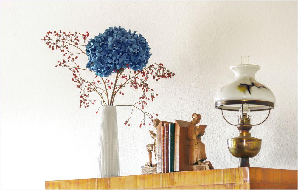Blue hydrangea with rosehip branch