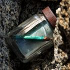 blue pencil in glass jar register on mountain peak