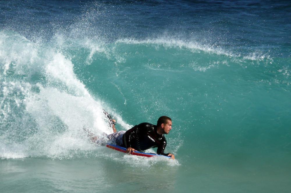 Bodyboarder at Sandy Beach