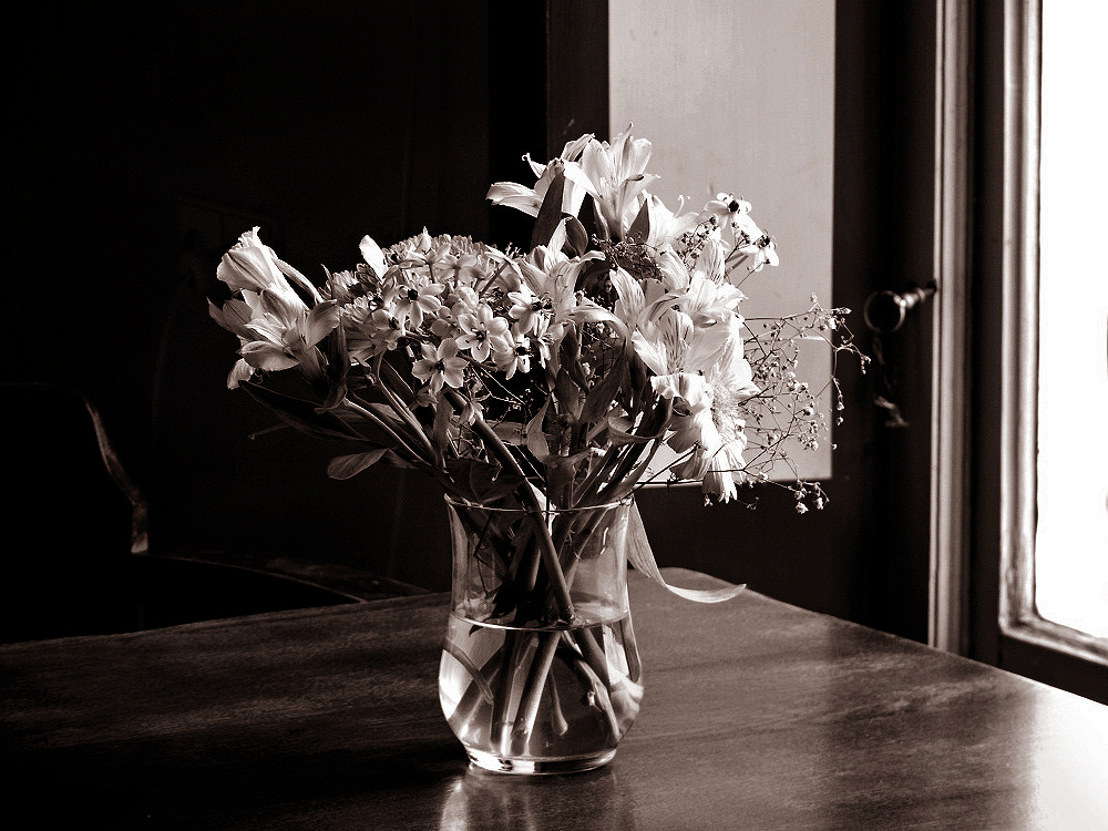Bouquet of flowers on a rustic dining table