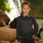 Boy in front of a watherfall in province Ratanakiri, Cambodia 2009