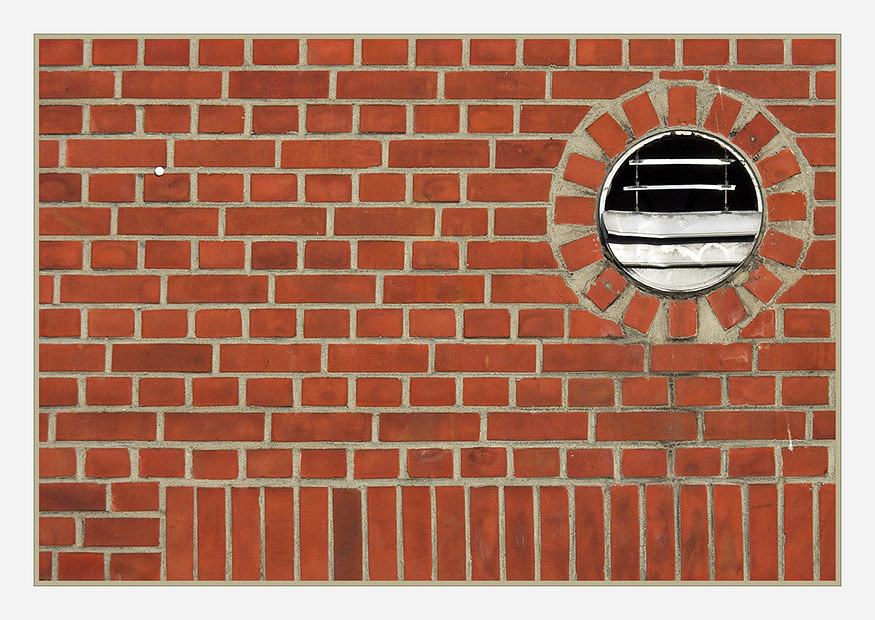 brick wall with fan