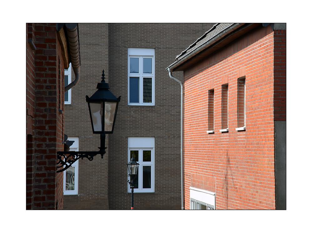 Brickwalls, street lights and windows