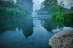 Bridge over foggy water