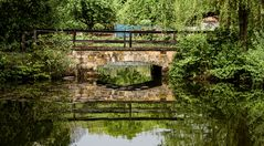 bridge over reflecting water
