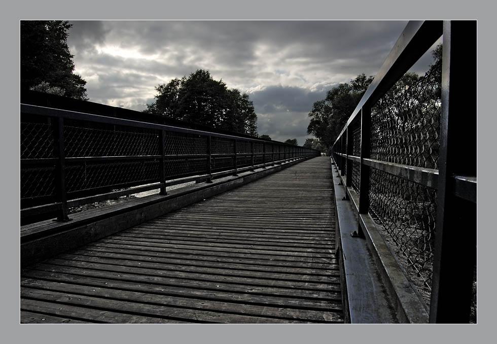 Bridge under troubled sky