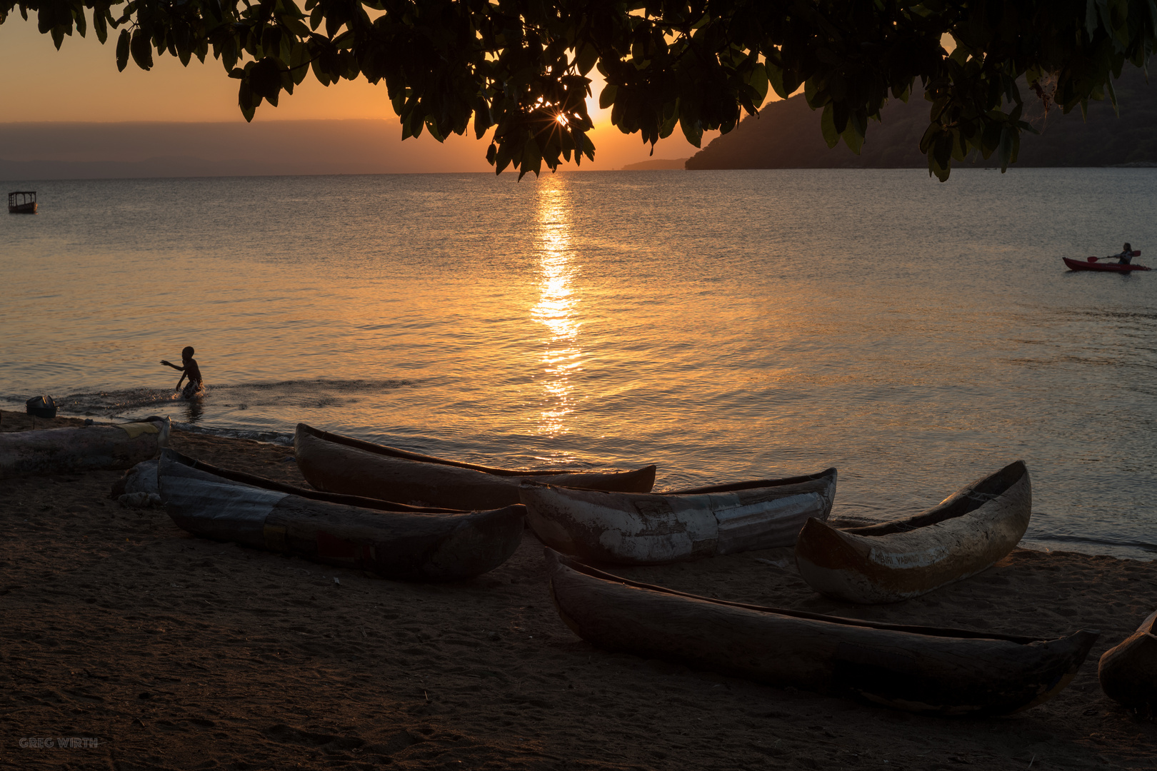 Canoes in the sunset again, I know...