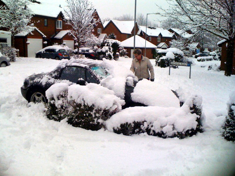 Carol digging out her car two