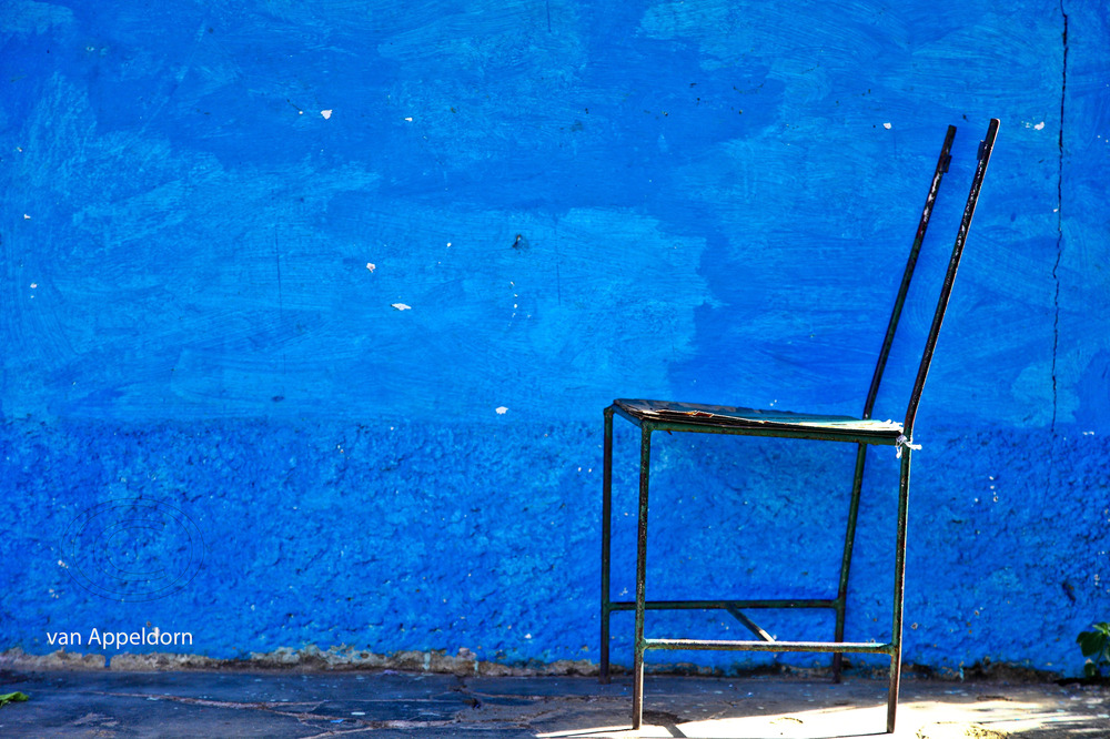 chair and blue wall photo image still life subjects images at