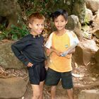 Children play for money from tourist in province Ratanakiri, Cambodia 2009