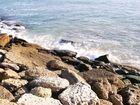 Choque de agua en las piedras de Chipiona