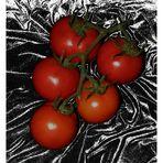 Cinco tomates.