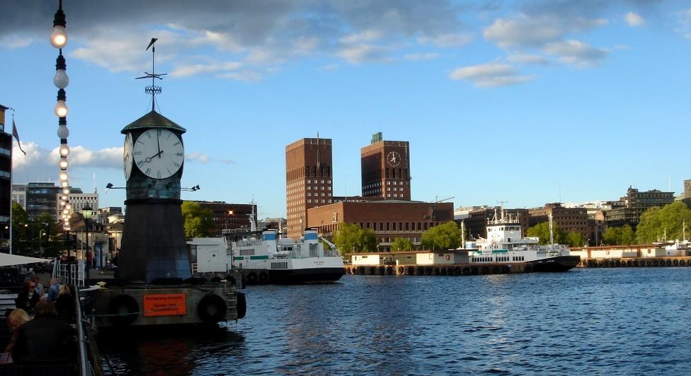 """Clock tower, brown buildings, port....."""