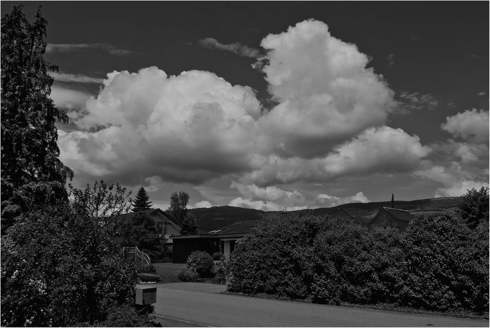 CLOUDS over the Roofs