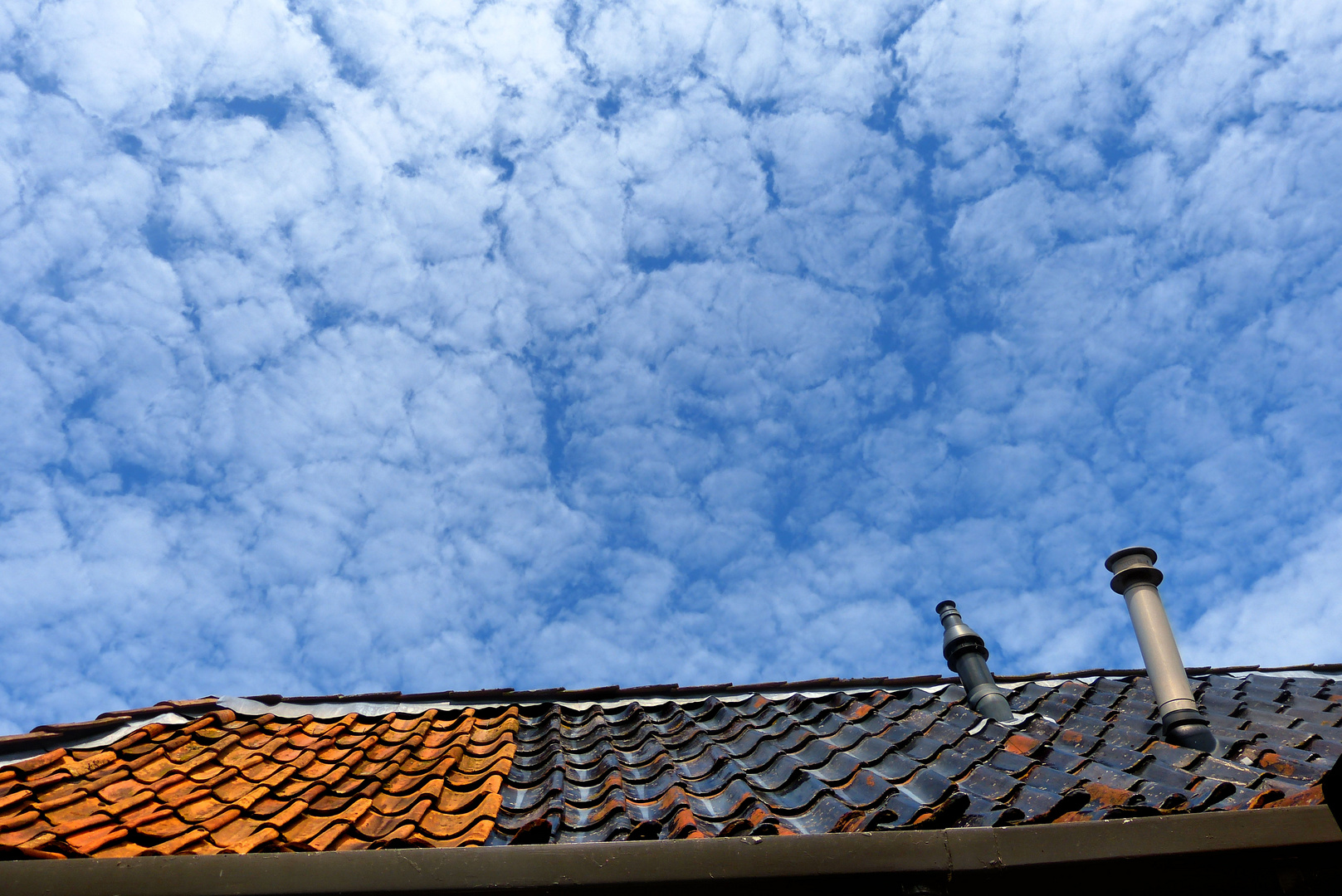 Clouds over the rustic roof