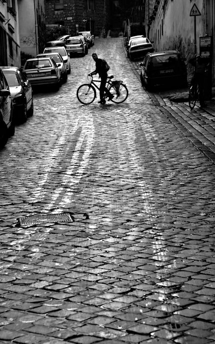 Cobbles and a cyclist