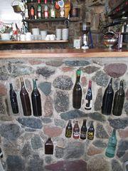 ..Dans un bar Corse...