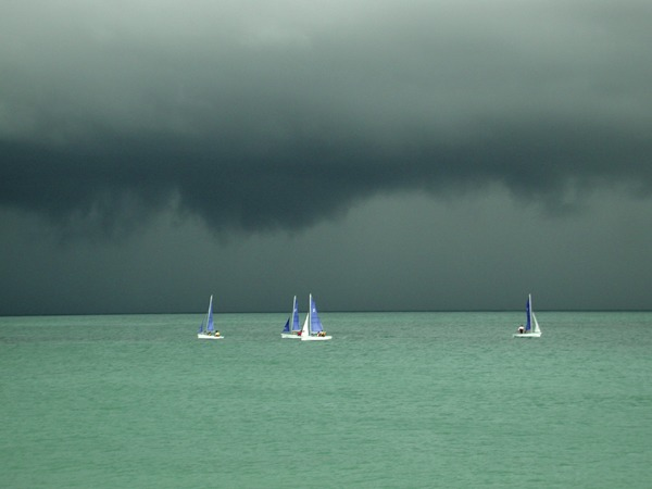 Dark clouds blue sails