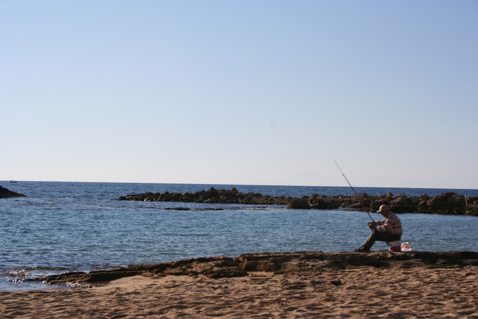 Der Angler am Meer