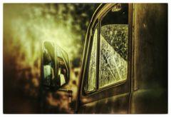 Der Fahrersitz im Aussenspiegel